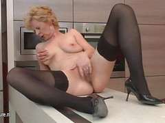 Ugly mature slut loves to masturbate in her kitchen Thumb