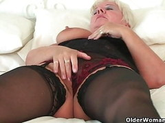 Curvy granny in black stockings rubs her old clit Thumb