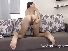 Scarlett Nika strips naked and shows body on couch Thumb
