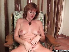 Mature redhead Liddy gets finger fucked by photographer Thumb