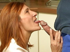 Redhead housewife takes a fucking in her kitchen Thumb