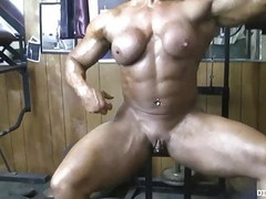 Powerful naked bodybuilder shows her big clit in the gym Thumb
